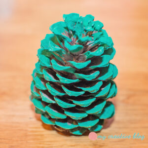 Paint pinecones green.